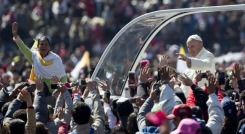 Pope Francis waves to the crowd, aboard the popemobile in Mexico City's main square, the Zocalo, Saturday, Feb. 13, 2016. Pope Francis kicks off his first trip to Mexico on Saturday with speeches to the country's political and ecclesial elites. The pontiff's five-day visit will include a very personal prayer at the Virgin of Guadalupe shrine. (AP Photo/Moises Castillo)